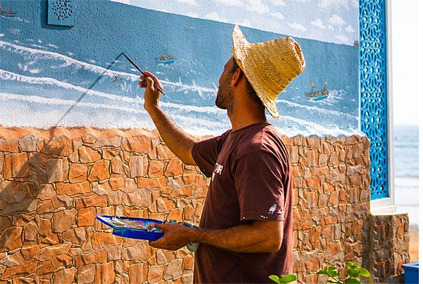 man-painting-mural