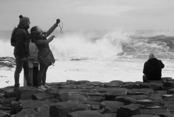 group-taking-selfie-at-giant's-causeway